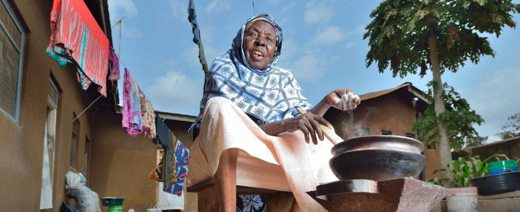Mwanamisi preparing a meal in front of her home in Tanzania
