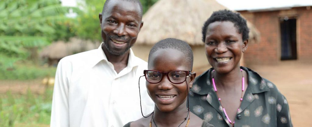 At Mengo Eye Department after cataract surgery: Happy Milly with her father Wilfred and mother Dorica