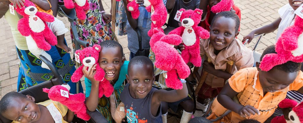 children holding healinghug bears