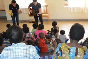 Ryan Kelly and Michael O'Dwyer from Celtic Thunder singing to kids