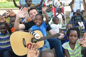 Ryan Kelly from Celtic Thunder singing with kids in Africa
